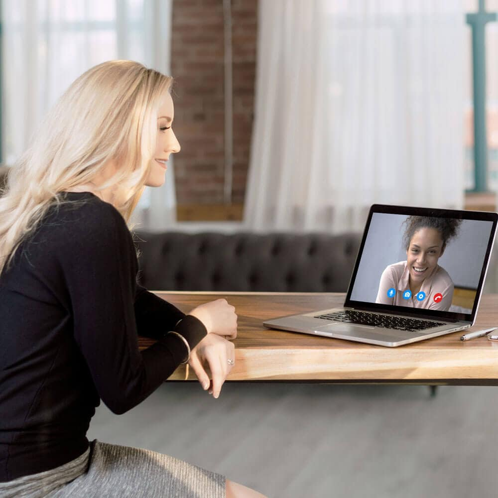 Dr. Leah Richardson doing a video call with a female patient